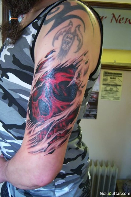 Scary Skull And Ripped Skin Tatto