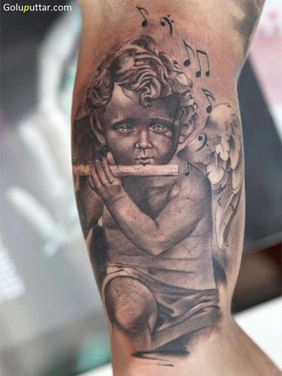 3D Angel Baby And Flute Tattoo On Bicep - Copy