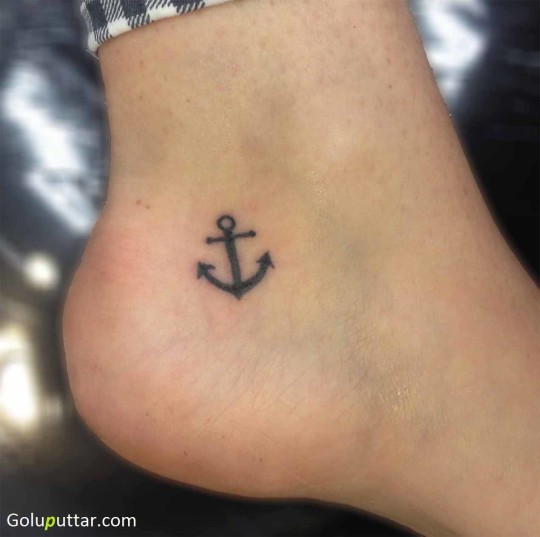 Lovely Tattoo Of Tiny Anchor On Ankle - Copy