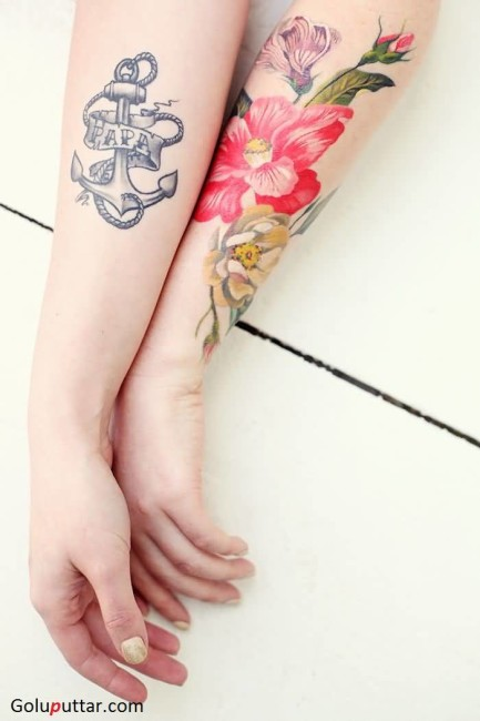 Mind Blowing Anchor And Lily Flower Tattoo On Sleeve
