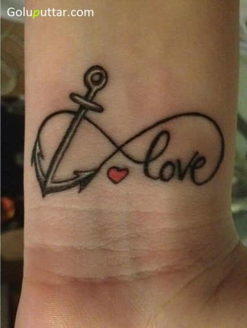 Mind Blowing Anchor Love Tattoo On Wrist With Little Heart