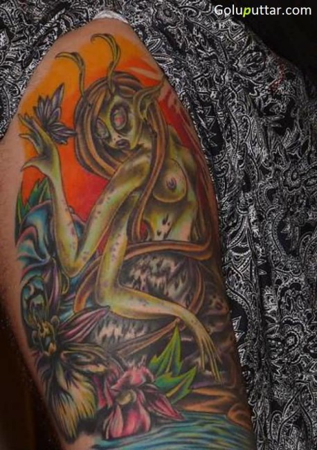 Weird Alien Woman Tattoo On Back