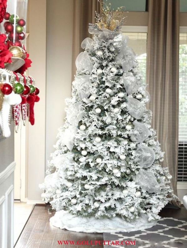White Themed Christmas Tree Reminding Of The Snowing
