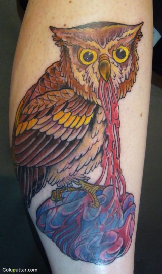 Tattoo Of Cool Animated Owl Eating Human Heart - Copy