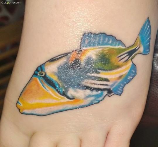 Another Perfect Tattoo Of Aqua Fish On Girl Foot