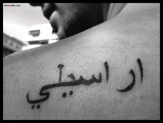 Awesome Back Tattoo Of Arabic Text For Men
