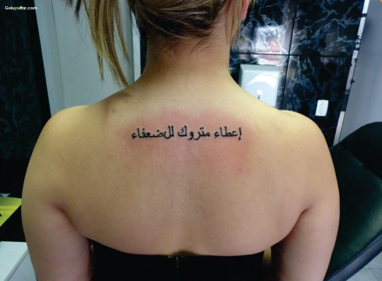 Impressive Arabic Word Tattoo For Girl Back