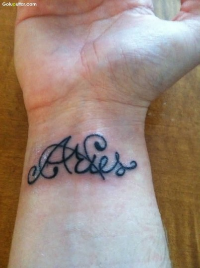Women Show Aries Text Tattoo On Wrist