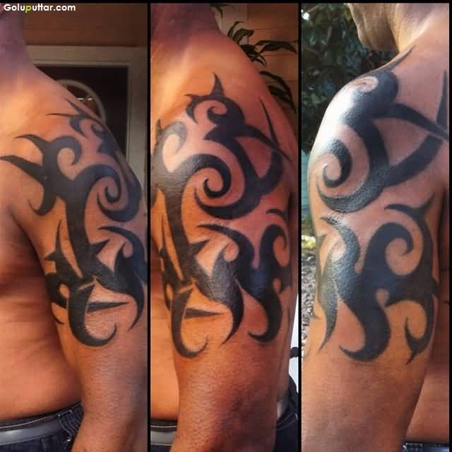 Awesome Men Show Tribal Armband Tattoo On Left Upper Arm