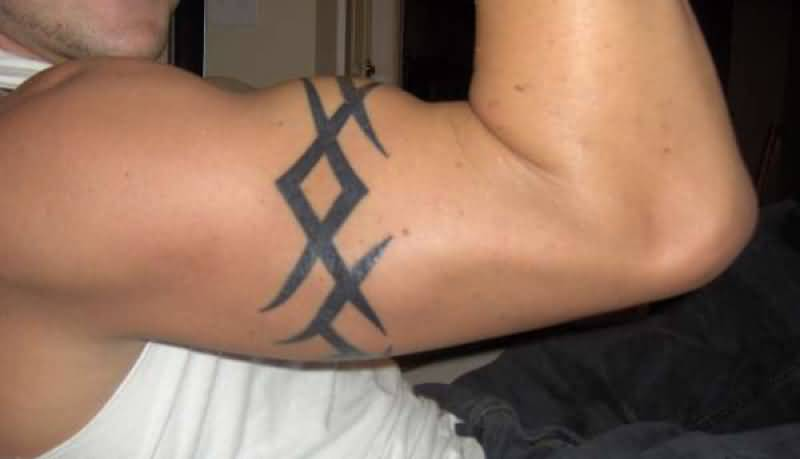Awesome Men Show Tribal Armband Tattoo On Right Arm