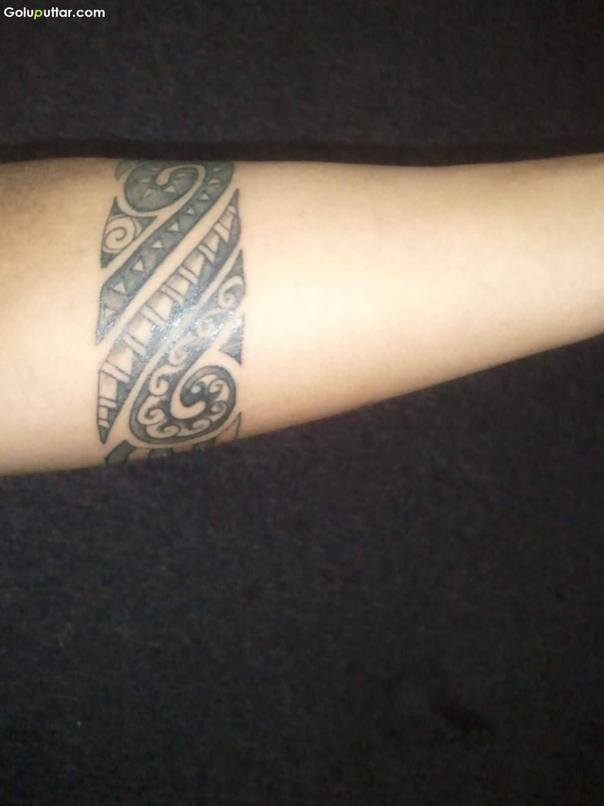 Cool Tribal Maori Armband Tattoo On Lower Arm