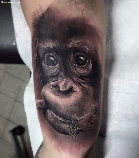Best 3d face tattoo on arm ever photos and ideas for Monkey face tattoo