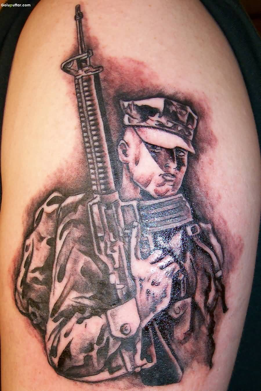 Man Show Awesome Army Sniper Tattoo On Sleeve