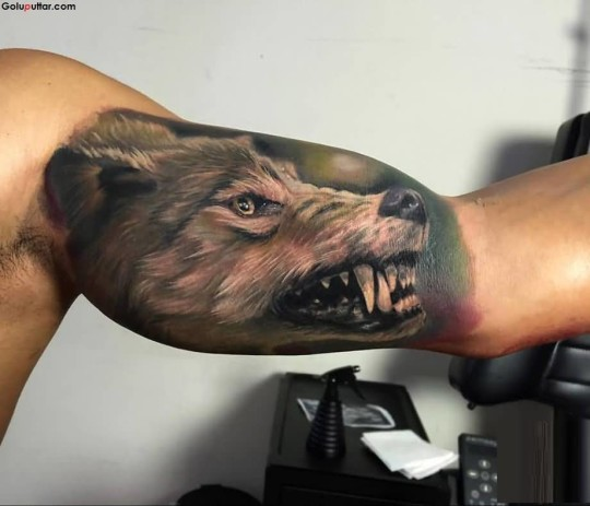 Man's Arm Decorated With Scary 3D Wolf Face And Teeth Tattoo