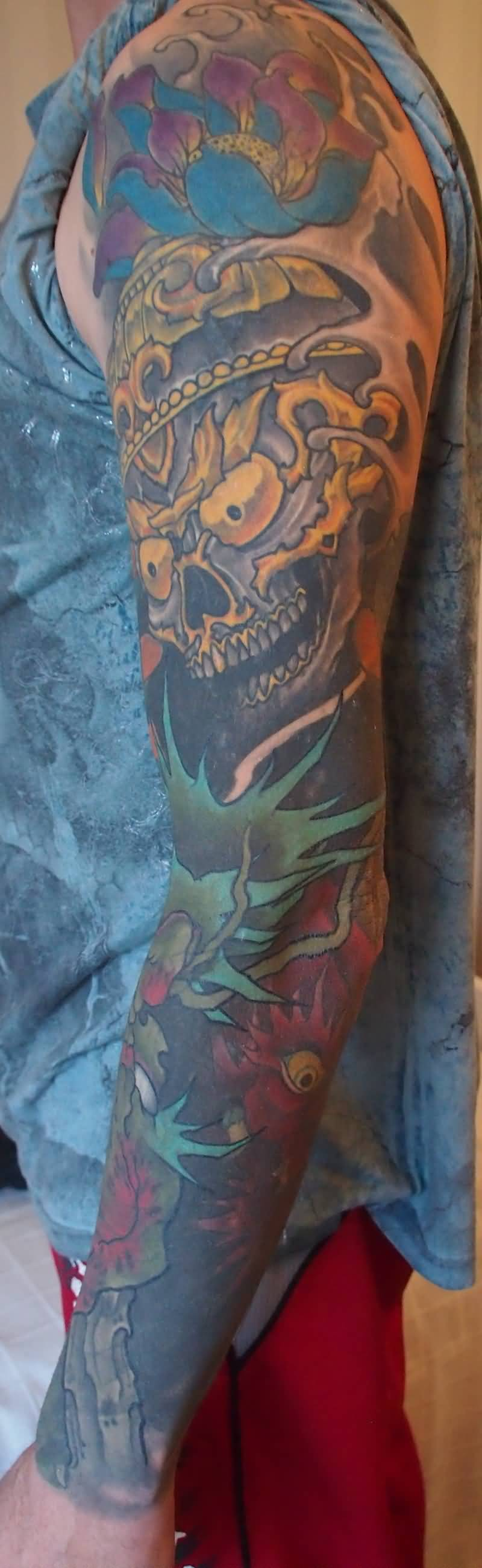 Awesome Asian Skull And Green Leaf Tattoo On Sleeve Goluputtar