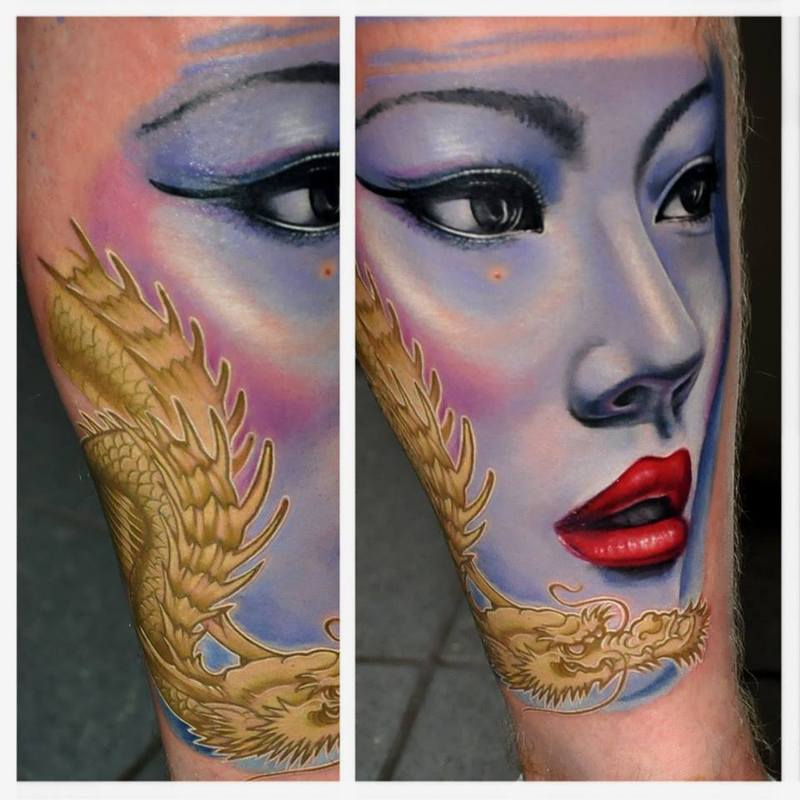 Blue Ink Asian Girl Face Tattoo On Sleeve With Dragon