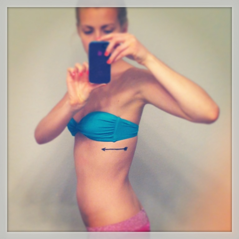 Superb Rib Side Tattoo Of Arrow For Cool Girl