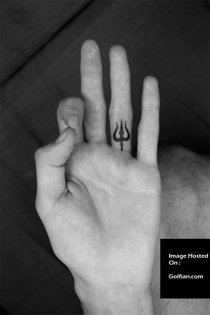 Unique Small Trishul Tattoo On Ring Finger