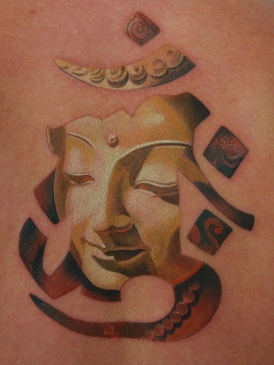 3D Buddha Face In Om Sign Tattoo On Back Body