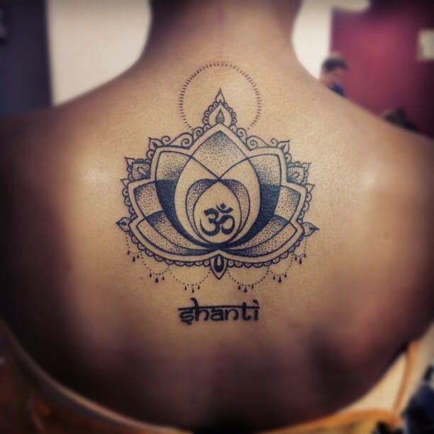 Black Ink aDotted Om Sign In Lotus Flower Tattoo On Girl Back Body