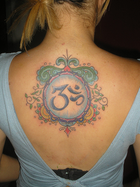 Blue And Green Ink Lovely Om Sign Tattoo On Beautiful Girl Back Body