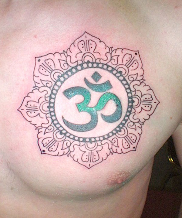 Green Om Sign Tattoo With Flower Outline On Men Chest