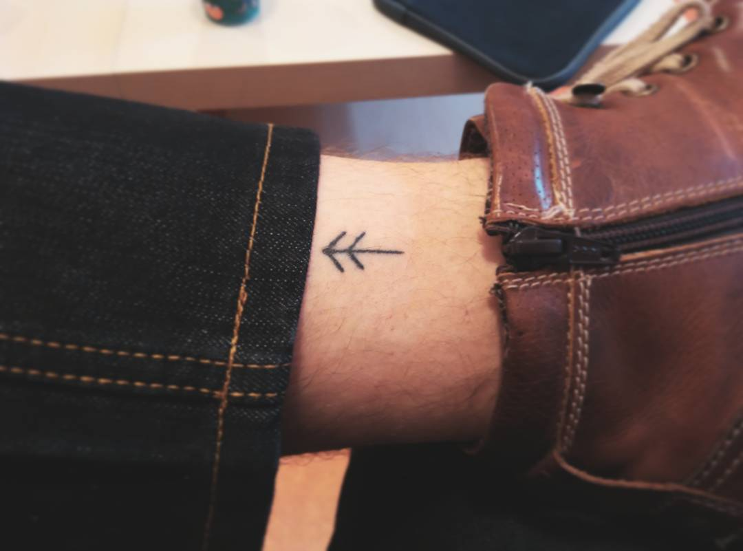 Men Leg Decorated With Famous Simple Small Arrow Tattoo