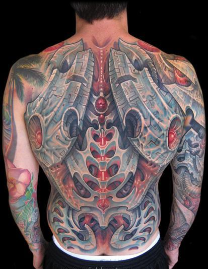 7biomechanical tattoo idea