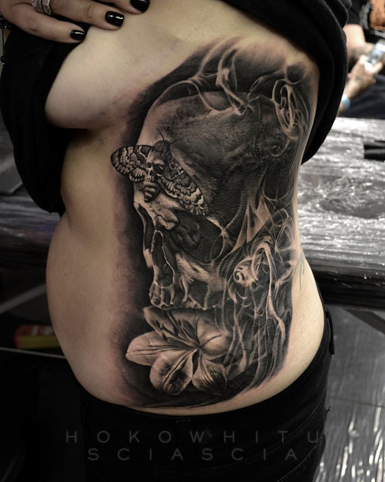 3D Skull With Flower Tattoo On Women Left Side Rib By Hokowhitu Sciascia