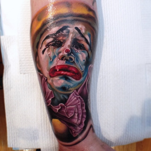 Attractive 3D Crying Clown Head Tattoo On Forearm By Fabz