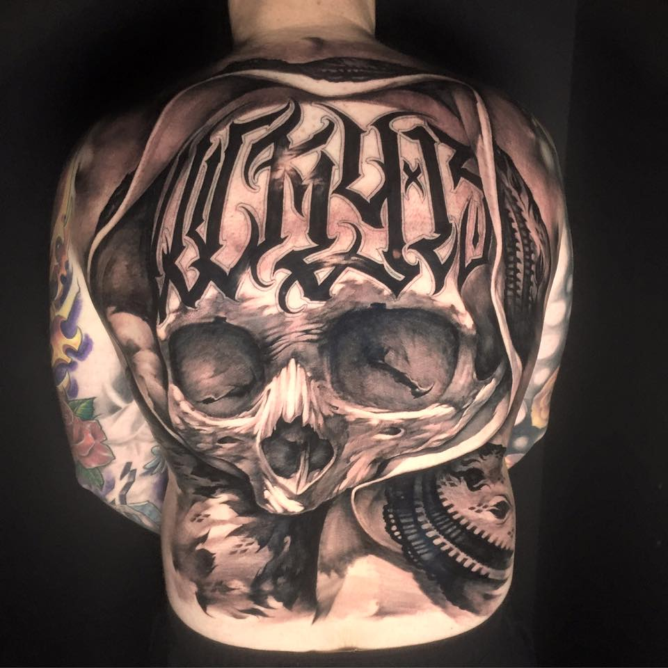 Attractive Black And Grey 3D Skull Tattoo On Man Full Back By Benjamin Laukis