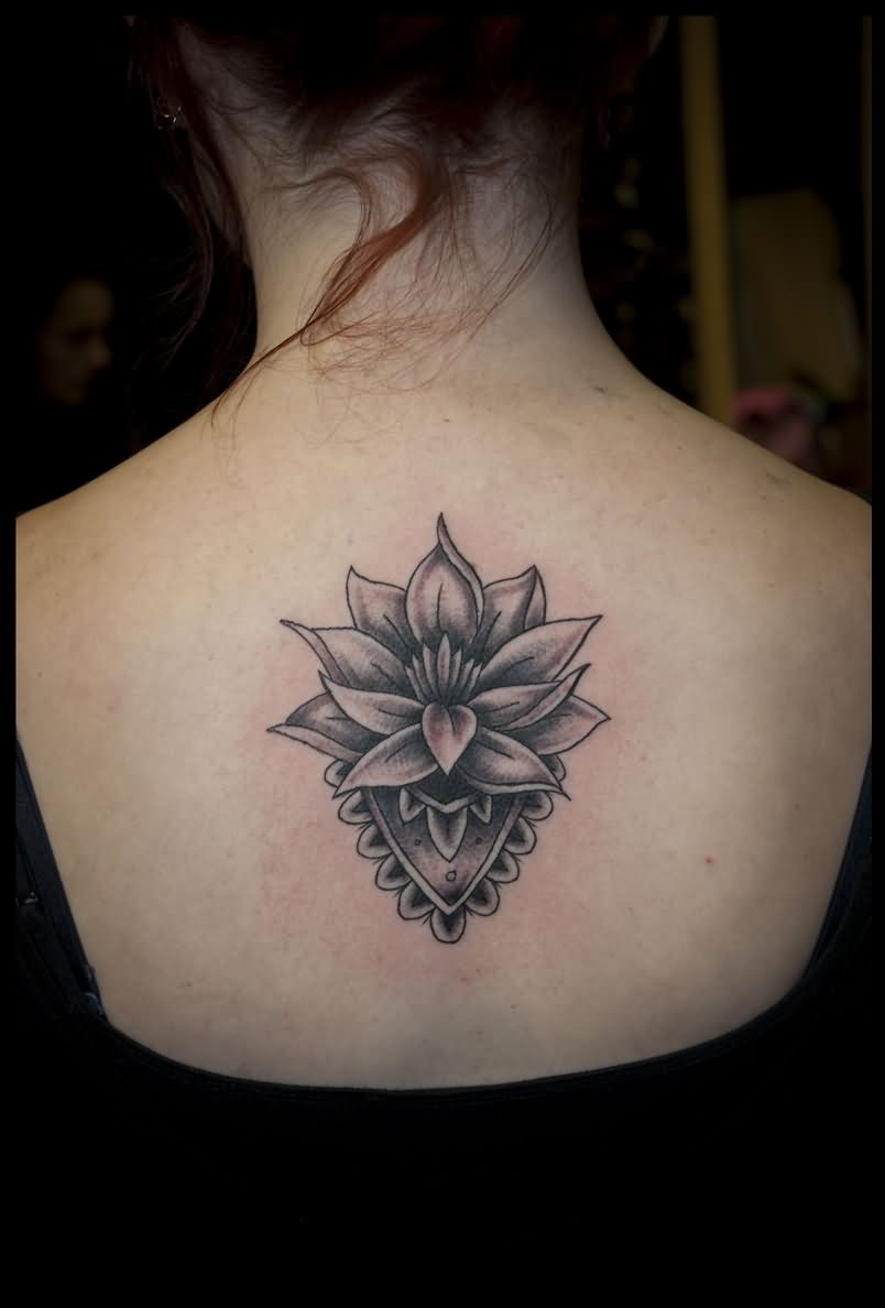 Attractive Black And Grey Lotus Flower Tattoo On Girl Upper Back