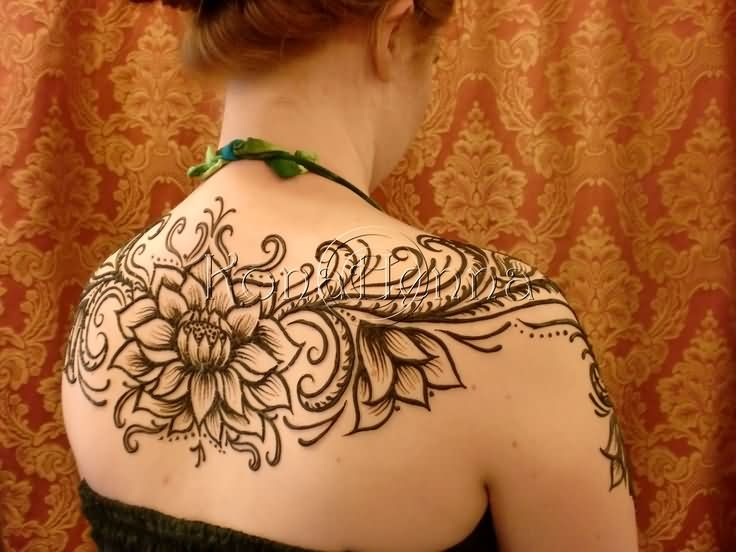 Attractive Black Ink Henna Lotus Tattoo On Girl Upper Back