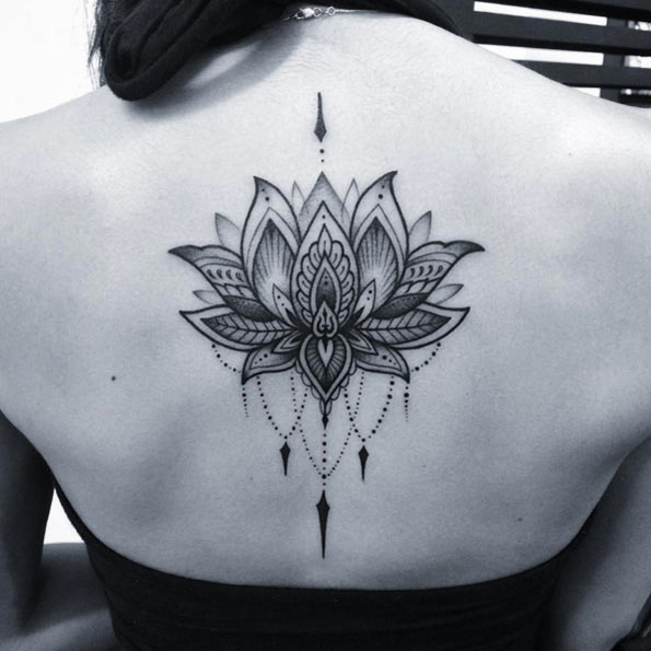 Attractive Lotus Flower Tattoo On Girl Upper Back By Nick Hart