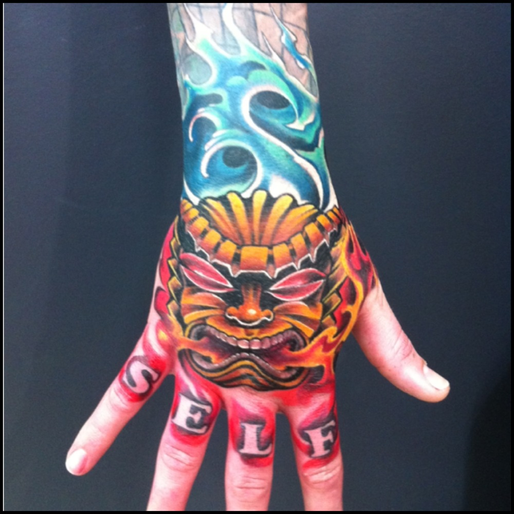 Attractive Mask Tattoo On Right Hand By Fabz