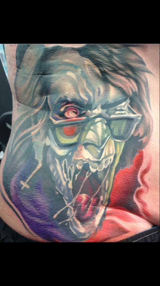 Attractive Zombie Face Tattoo On Man Right Side Rib By Fabz