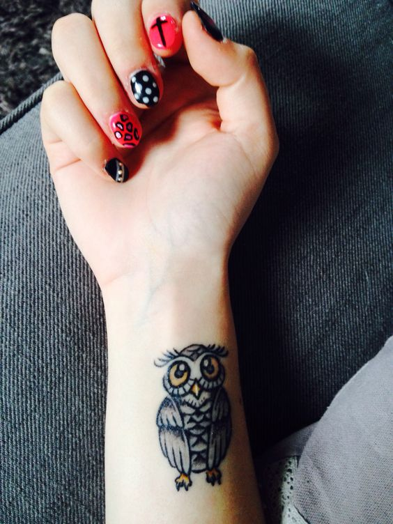 Awesome Black Ink Owl Tattoo On Girl Right Wrist