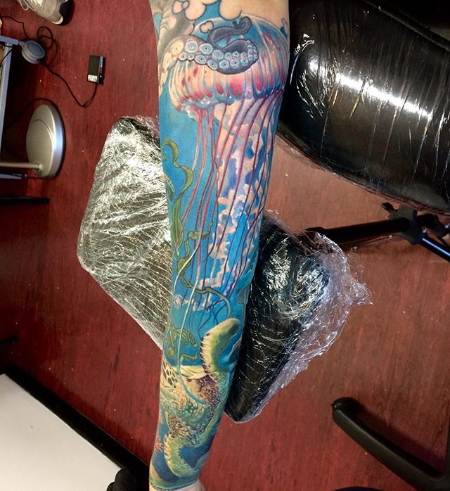 Awesome Jelly Fish With Octopus Tattoo On Left Arm By Frederick Bain