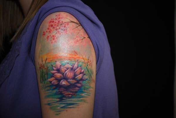 Awesome Lotus Flower In Water Tattoo On Women Left Shoulder