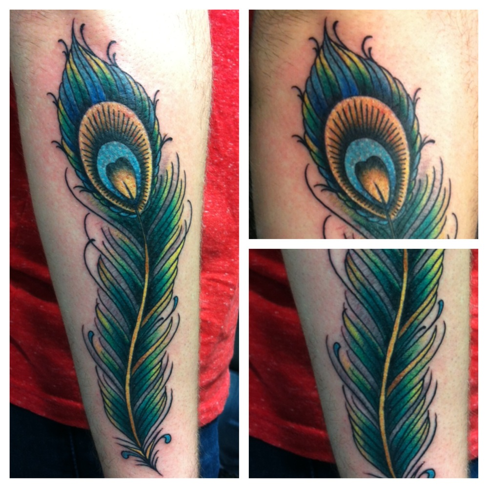Awesome Peacock Feather Tattoo On Right Arm By Justin Brooks