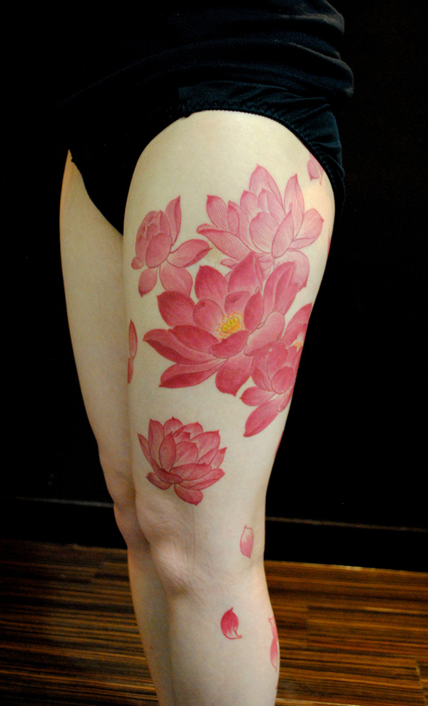 Awesome Pink Ink Lotus Flowers Tattoo On Girl Left Thigh