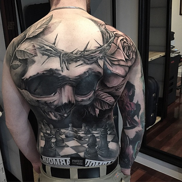 Black And Grey 3D Skull With Chess Tattoo On Full Back By Benjamin Laukis