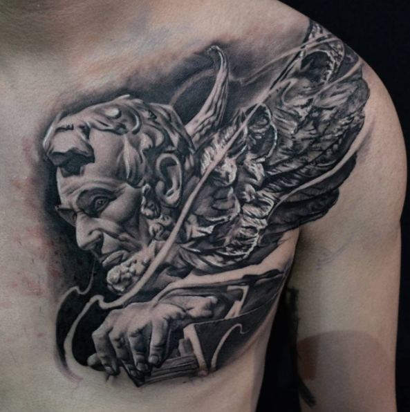 Black And Grey Abraham Lincoln Face With Wings Tattoo On Man Left Chest By Hokowhitu Sciascia