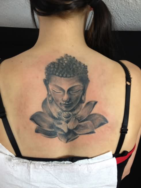 Black And Grey Buddha Head With Lotus Flower Tattoo On Girl Upper Back