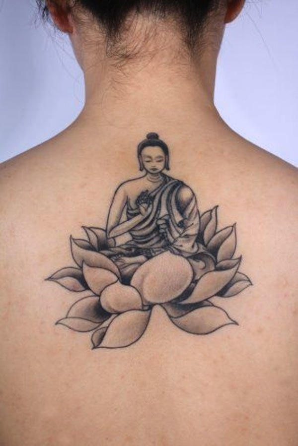 Black And Grey Buddha On Lotus Flower Tattoo On Girl Upper Back