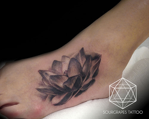 Black And Grey Lotus Flower Tattoo On Foot