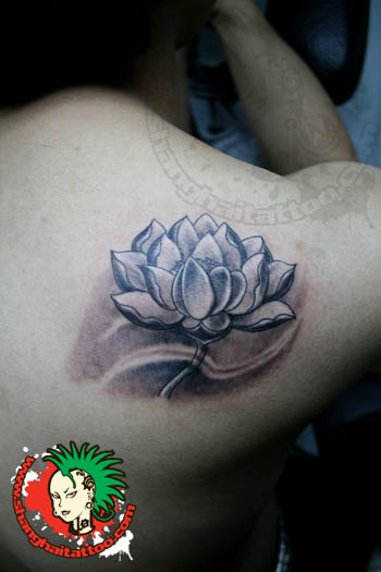 Black And Grey Lotus Flower Tattoo On Right Back Shoulder