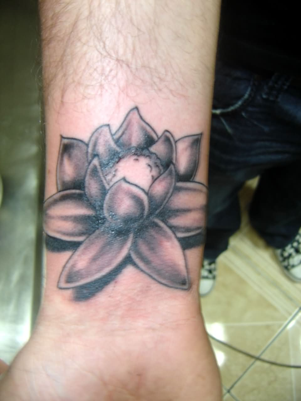 Black and grey lotus flower tattoo on wrist photos and ideas black and grey lotus flower tattoo on wrist izmirmasajfo