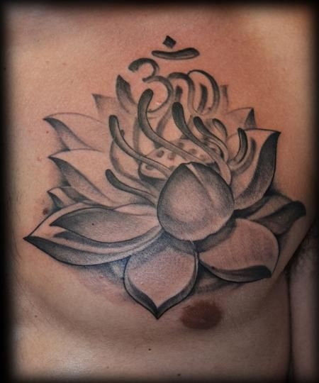 Black And Grey Lotus Flower With Om Tattoo On Man Chest