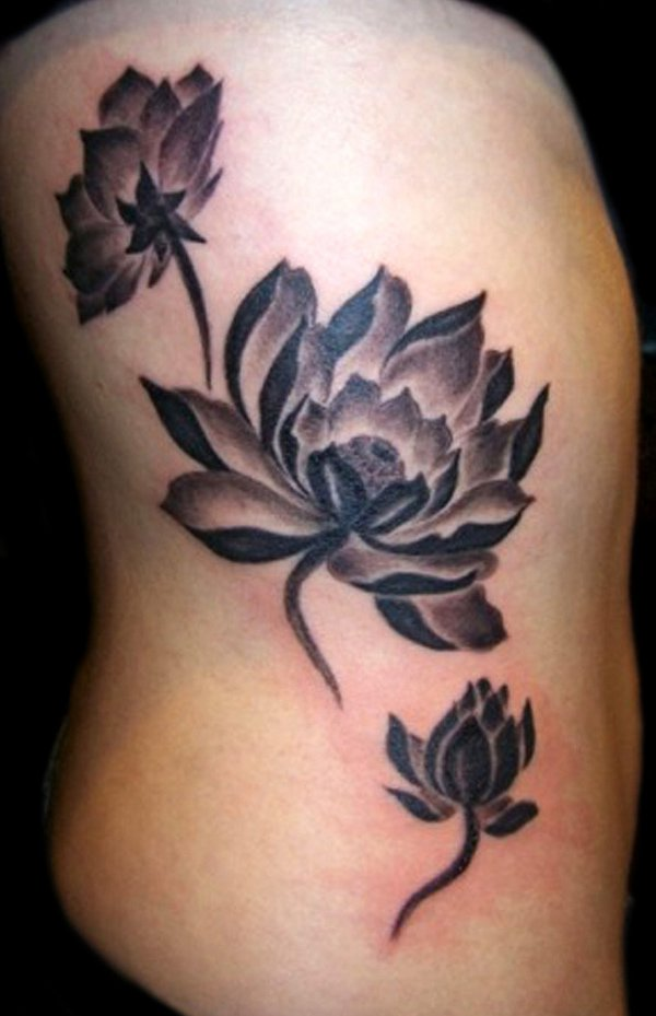 Black And Grey Lotus Flowers Tattoo On Right Side Rib